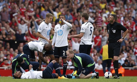 Tottenham Hotspur's Etienne Capoue receives treatment. He will be out for 1 month
